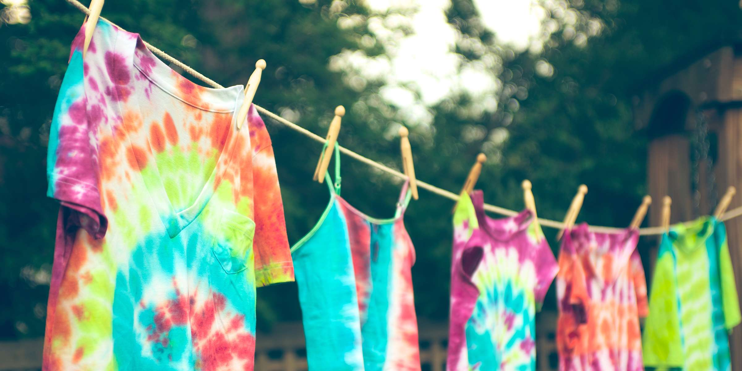 Groovy tie dyed tee shirts hanging from a clothes line